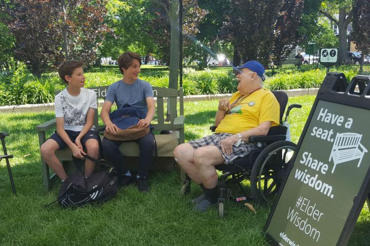 Two youth join Bob at the #ElderWisdom bench in Toronto's Trinity Bellwoods Park