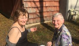 Susan Wilson and Betty Findlay soaking up a bit of sun during a visit to Camp Schlegel at Shady Pines.