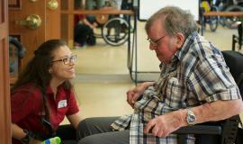 Team Member offers quality care to resident in a wheelchair
