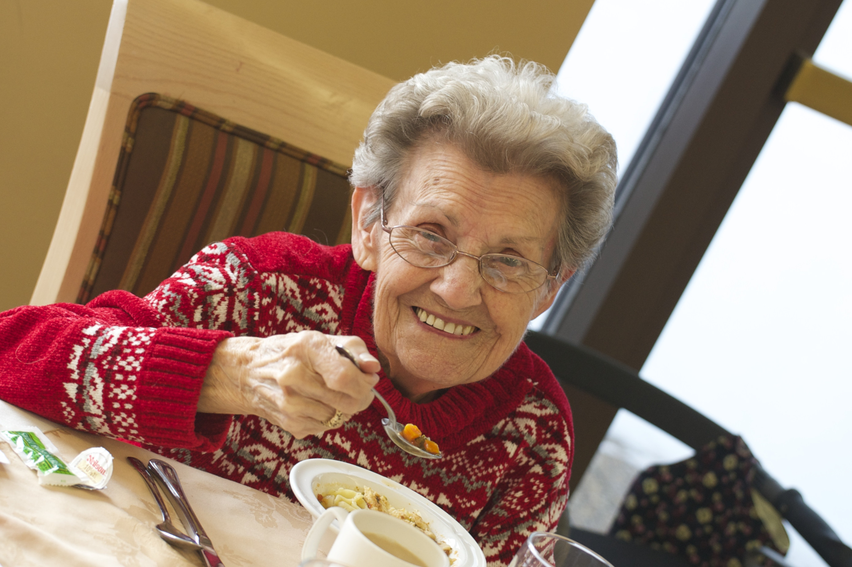 Senior eating soup